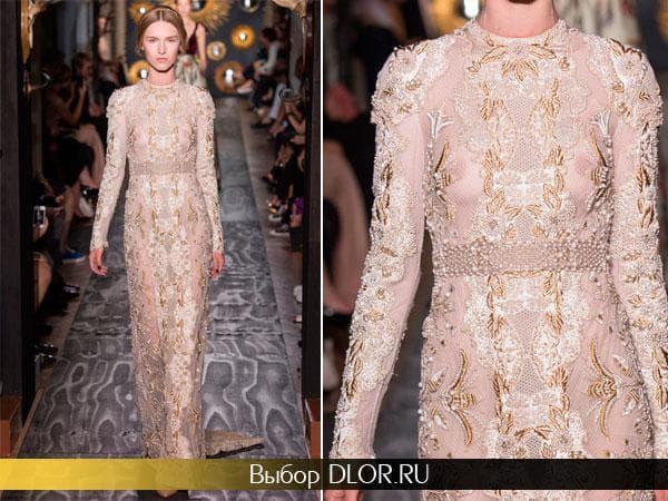 Светлое шикарное платье украшенное камнями и жемчугом и золотой нитью